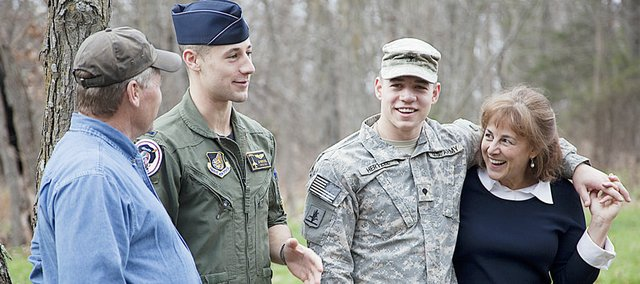 The Hertzel family, of rural Baldwin City, was surprised to learn that sons, 1st Lt. Jondavid Hertzel, 26, a fighter pilot stationed in Kunsan Air Base, South Korea, second from left, and his brother, Army specialist Zach Hertzel, 21, a combat medic serving in Baghdad, second from right, both managed to get leave from the service to be home for Thanksgiving. At left and right are the young men's parents, David and Camille Hertzel.