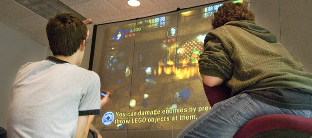 "Tonganoxie teens play ""Lego Indiana Jones: The Original Adventures."" after school at the Tonganoxie Public Library."