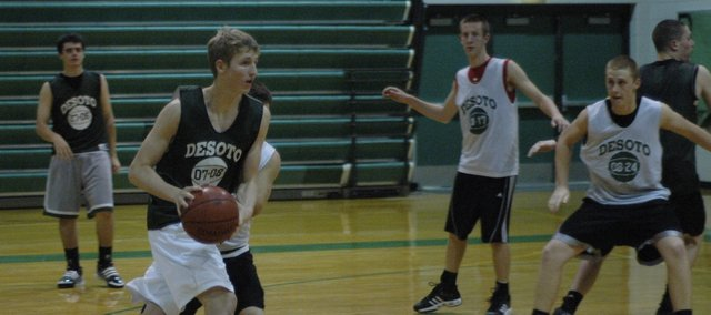 Brandan Philbrook looks to pass to an open teammate during a recent basketball practice at De Soto. The Wildcats open the season against Maranatha Thursday in De Soto.