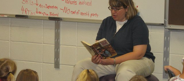 Michelle Ablard, Basehor Elementary fifth-grade teacher, reads to all the fifth-graders on the first day of the 2009-2010 school year.