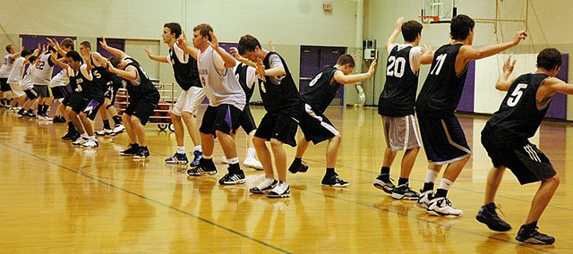 Baldwin High School boys' basketball players work on defensive slide drills during practice last week. The Bulldogs will play their first game Friday at Central Heights.