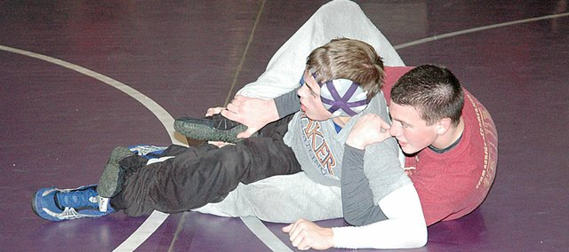 Baldwin High School wrestlers practice technique moves Tuesday afternoon. Pictured here are junior Greg Schiffelbein, right, and senior Josh Hanson. The Bulldog wrestling squad will begin its season Saturday at the Blazer Invitational in Gardner.