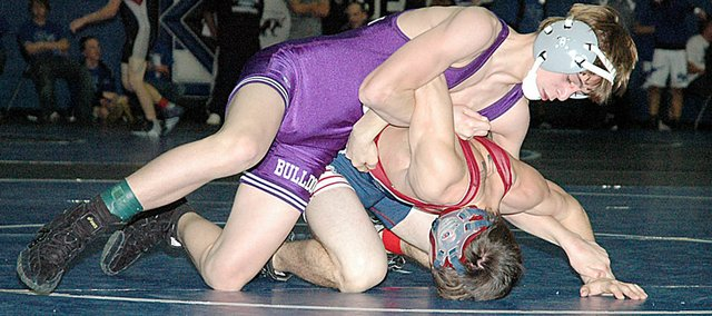 Baldwin High School freshman Bryce Shoemaker, left, won the 103-pound weight class Saturday at the Blazer Invitational in Gardner. Shoemaker helped the Bulldogs finish third out of 16 teams. There will be a full story in Thursday's Signal.
