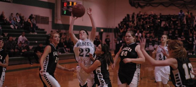 Shelbi Petty (22) drives to the basket during the first half against Maranatha Thursday in De Soto. Petty made seven three-pointers in De Soto's 56-22 win.