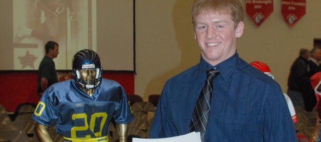 Brandon Leppke, Basehor-Linwood senior quarterback, poses with the Frank Fontana trophy at the Simone Awards ceremony on Tuesday, Dec. 8, 2009, at Olathe North High School. Leppke was one of four finalists for the Fontana Award, which goes to the best small-class player in the Kansas City metro area.