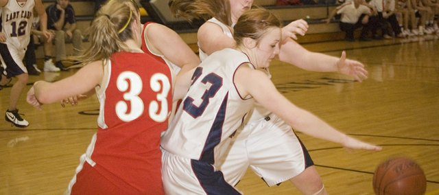 Eudora High senior Shea Lounsbury wins the position battle inside against Tonganoxie freshman Hannah Kemp in the seventh-place game of the Paola Invitational on Friday afternoon. Eudora prevailed, 40-39.