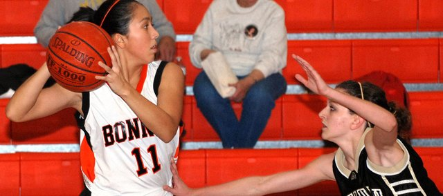 Yessenia Hernandez looks for a teammate to pass to during Bonner Springs' loss to Savannah (Mo.) in the consolation semifinals of the Metro Prep Classic.