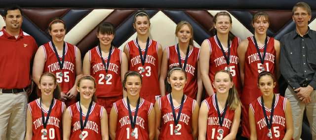 The Tonganoxie Middle School eighth-grade girls basketball A team finished second in the Kaw Valley League Tournament. Pictured are: (front row) Marissa Martin, Emily Soetaert, Morgan Oroke, Taylar Morgan, Alissa Donnelly, Kara Banks, (back row) head coach Ryan Scott, Elizabeth Patrick, Aly Bartholomew, Hunter Cook, Caly Ingle-Maxwell, Katelyn Waldeier, Emma Stilgenbauer and assistant coach Chris Weller.