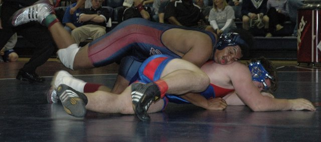 Boomer Mays wrestles Saturday at the Eudora Tournament of Champions. Mays finished third overall in the 215-pound weight class. Six Eudora wrestlers placed at the two-day tournament.