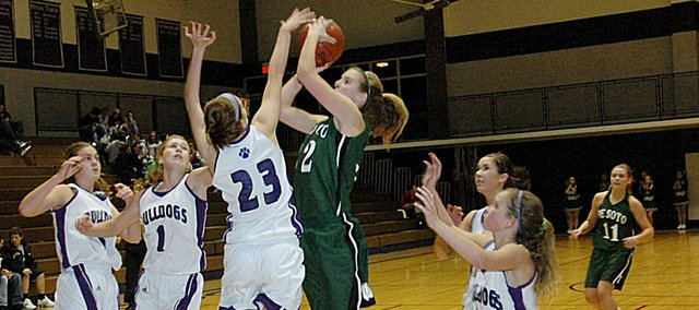 Baldwin High School senior Katie Brecheisen (No. 23) blocks a De Soto player's shot during the third quarter Tuesday. Four other Bulldogs surround the Wildcat during the shot attempt. The Bulldogs won their home opener 51-40.