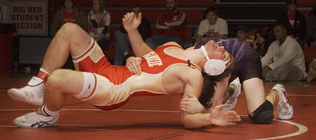 Jeremie Maus refuses to let his opponent get his back on the mat during the Tonganoxie High senior's championship match at the Randy Starcher Memorial Wrestling Invitational on Saturday. Maus, a 171-pounder, took first place in his weight class.