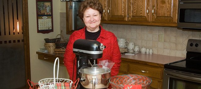 Tonganoxie's Debbie Becker selects recipes from various cookbooks to put together baskets of baked goods for friends and relatives each Christmas.