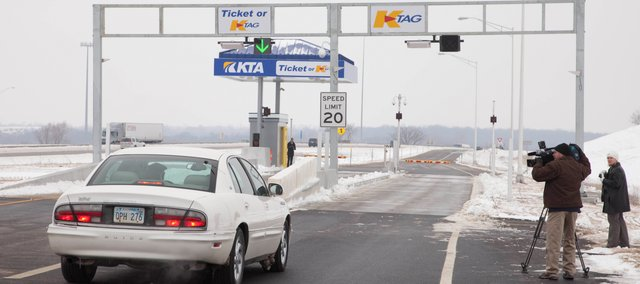 The first vehicle makes its way through the new Tonganoxie/Eudora Interchange at Milepost 212 on Interstate 70, Tuesday. The interchange is the first of its kind on the Kansas Turnpike and will be completely automated with K-Tag and  self-pay machines similar to those found in large retail or grocery stores.