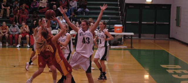 De Soto senior Katie Williams (43) defends in the low post against Atchison. With three wins, the De Soto girls basketball team has already equaled last year's win total. The Wildcats (3-3) have been competitive in their first six games.