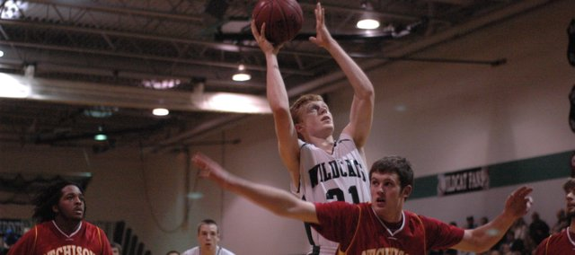 Paul Stallbaumer (31) goes up strong for two points against Atchison in De Soto's last game before break. The Wildcats (5-2) begin league play Friday night at Paola. The Wildcats beat the Panthers 47-35 last year.