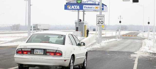 The first vehicle makes its way through the new Tonganoxie/Eudora Interchange at Milepost 212 on the Kansas Turnpike on Dec. 29. The interchange could be a boon to Eudora businesses, but increased truck traffic is a worry to some. The interchange is the first of its kind on the turnpike and will be completely automated with K-Tag and self-pay machines similar to those found in large retail or grocery stores.