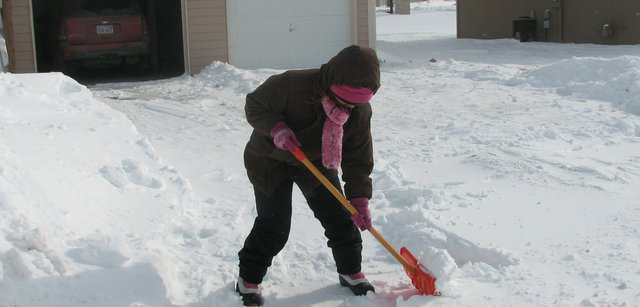 Basehor resident Jennifer Jones shovels the driveway of her home Thursday on 161st Terrace. Wednesday's snowstorm brought the city about 4.5 inches of snow.