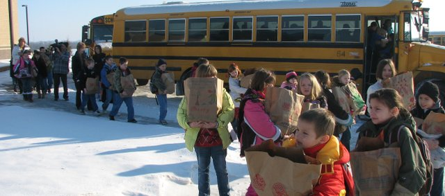Basehor Elementary third-, fourth- and fifth-grade students arrive Monday morning, bags of school supplies in  their arms, at their new school off 155th and Hickory streets.