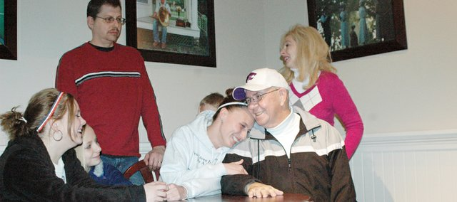 Amanda Trober hugs her father-in-law Jack Freeman, to whom she donated a kidney. The pair are surrounded by Amanda's daughters, Haley and Brooke Trober, her husband, Jerry Trober Jr., her son, Logan Trober, and Jack's wife, Brenda Freeman.