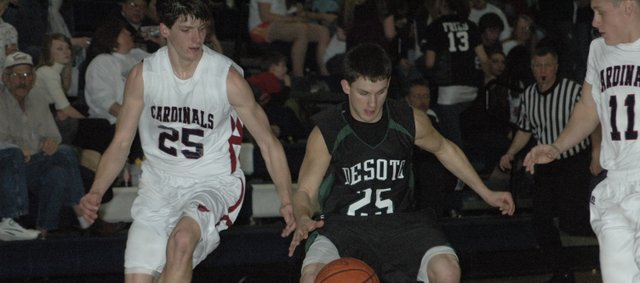Dylan Burford steals the ball during the second half Friday night at Eudora. The De Soto boys won 49-40 and the girls won 47-30.