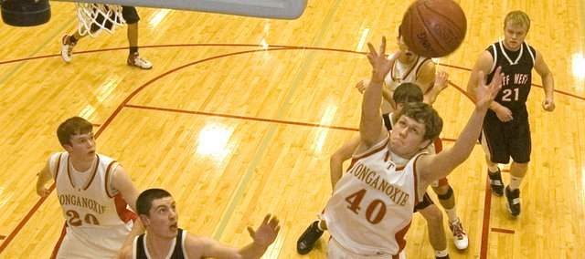 Tonganoxie High senior Justin Jacobs reaches out for an offensive rebound in the first quarter of the Chieftains&#39; 60-50 victory over Jeff West on Tuesday night in the opening round of the Tonganoxie Invitaional. 