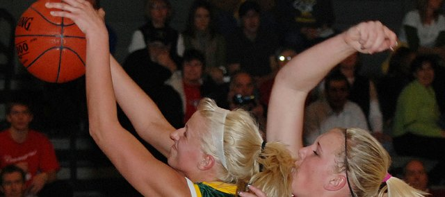 Basehor-Linwood senior Cassy Bever hauls in a rebound during the Bobcats' 51-45 loss to Ottawa in the first round of the Basehor-Linwood Girls Basketball Invitational.
