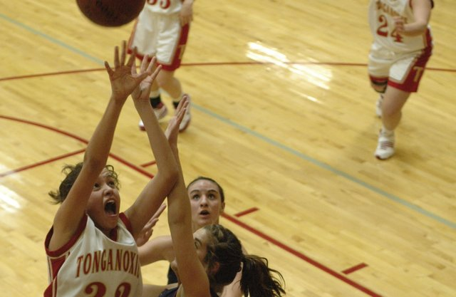 Tonganoxie High's Tavia Brown goes up strong over Eudora's Sydney Schmille during the second quarter Tuesday in the first round of the Tonganoxie Invitational. Tonganoxie beat Eudora 48-40.
