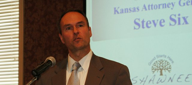 Kansas Attorney General Steve Six visits with Shawnee Chamber of Commerce members.