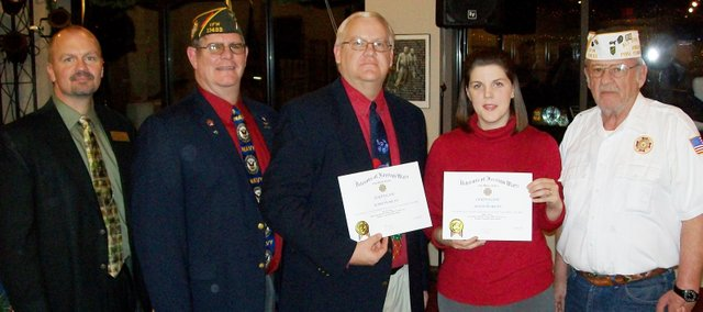 Basehor-Linwood High School teacher David Svoboda and Basehor Elementary teacher Hillary Raple got their National Citizenship Education Teachers Award certificates. The teachers were congratulated by Basehor-Linwood Superintendent David Howard (far left), Basehor VFW Quartermaster Daniel Stueckemann, and Basehor VFW Commander Fred Box (far right).