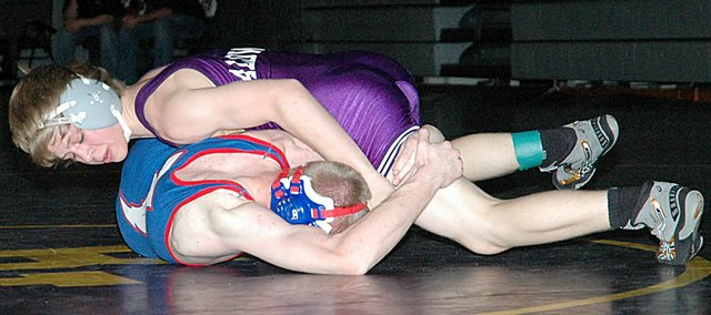 Baldwin High School sophomore Andrew Morgan, top, defeated his Santa Fe Trail opponent to place fifth in the 112-pound weight class Saturday at the Bobcat Classic. BHS finished 10th out of 32 teams.