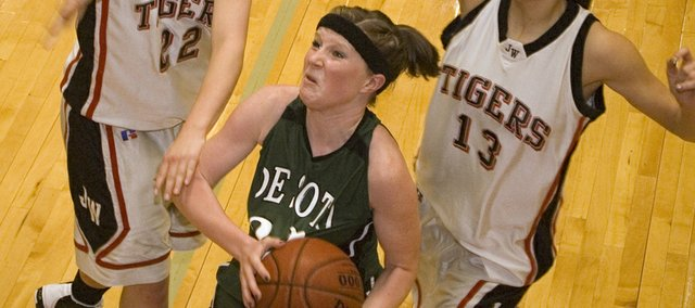 De Soto High junior guard Shelbi Petty draws contact while going in for a layup in the closing seconds of the first half against Jeff West on Thursday at the Tonganoxie Invitational. Petty scored a game-high 28 points to help the Wildcats pick up a 61-56 victory in the consolatioin bracket.