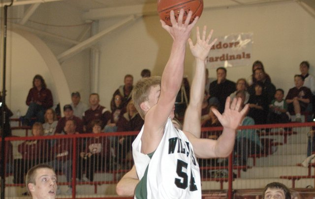 Joey Johnson drives in for a layup during the second quarter against Silver Lake Friday at Tonganoxie. De Soto lost the game 44-37.