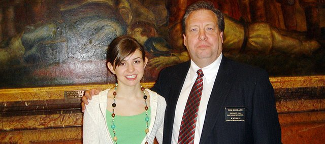 State Sen. Tom Holland, D-Baldwin City, is expected to announce he's running for governor this afternoon. The Signal will update this story with the announcement and there will be a story in tomorrow's edition. Here he's pictured with Heather Garcia, a 2008 Baldwin High School graduate, whom Holland honored in the Senate for her numerous state championships as a runner for BHS's cross country and track teams. Garcia now competes for Boston College.