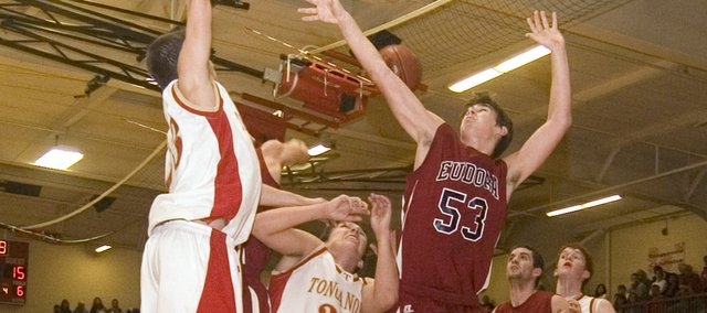 Tonganoxie High's Dylan Scates and Austin Vickers, as well as Eudora's Hawley Montgomery, try to locate a rebound in a Tonganoxie Invitational semifinal on Friday night. The Chieftains defeated Eudora, 61-50.