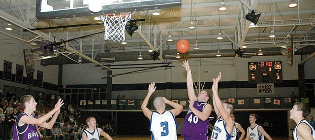 Baldwin High School senior Zach Wright (No. 40) scores two of his team-high 14 points during the second half Friday night. BHS beat Perry-Lecompton 53-40 to advance to the Baldwin Invitational Tournament championship at 5:30 p.m. Saturday.
