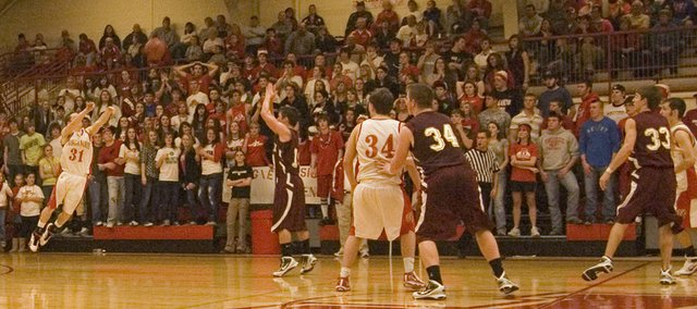 Tonganoxie High junior guard Jeremy Carlisle heaves a desperation three-pointer as time expires in the Chieftains' 46-43 overtime loss to Silver Lake in the Tonganoxie Invitational title game on Saturday night.
