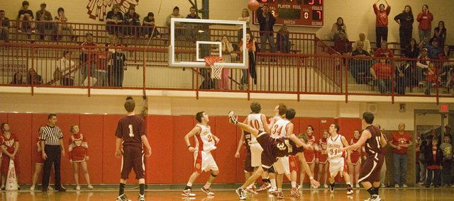 Tonganoxie High players follow the flight of the basketball after it was released by Silver Lake's Keenan Kruger just before time expired in the fourth quarter of the Tonganoxie Invitational on Saturday. The shot missed but THS fell in overtime, 46-43.