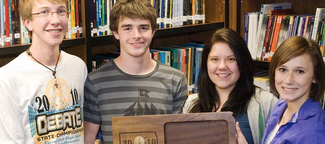 The Tonganoxie High School four-speaker debate team won the Class 4A state title in its category Saturday in Goddard. Team members are, from left, Austin Baragary, Nic Irick, Emily Jefferies and Alex Bartels.