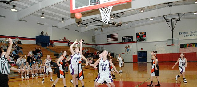 Baldwin High School junior Allison Howard is fouled on a drive to the basket Tuesday night. Howard led the Bulldogs with 11 points as they beat Bonner Springs 46-34 to win their 20th consecutive Top Gun Tournament opener.