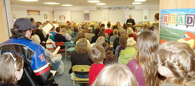 It was standing room only at Vinland Elementary School last Tuesday night as around 100 people attended a meeting to hear what a fact-finding committee has found so far in an effort to make additional budget cuts in the Baldwin School District. Among the considerations the committee is gathering information on is what could be saved by closing the elementary schools at Vinland and Marion Springs, which has brought strong reactions from those areas in past years. At the forefront of the photo is Gus Wegner, principal at both the rural schools, who explained the five-page outline the committee is researching with the hopes of reaching a March 5 deadline for the school board to consider. 