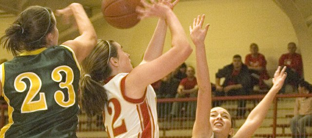 Tonganoxie High forward Danielle Miller runs into Basehor-Linwood&#39;s defense as Courtney Poe extends her arms and Megan Bergstrom blocks a shot from behind on Tuesday during the Bobcats&#39; 74-53 defeat of the Chieftains.