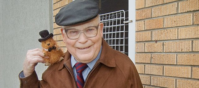 """Dr. Phil Stevens, also known as Tonganoxie Phil each Groundhog Day, did not see his shadow Tuesday. Stevens took on the role of Tonganoxie Phil for a Kansas City, Mo. radio station for a few years and continues the """"meteorology"""" role today. Pictured with him is a stuffed toy groundhog that a patient gave him a few years ago."""