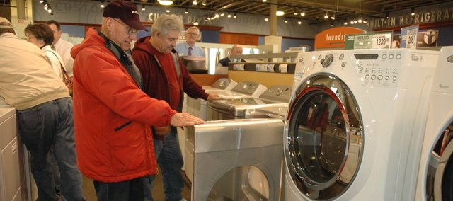 Don Bearley (left) and Richard Sheumaker look at some Energy-Star-rated appliances at Nebraska Furniture Mart, in Kansas City, Kan. Some Kansas residents participating in the State Energy Efficient Appliance Replacement Program will have the opportunity to receive rebates on the purchase of new Energy Star-rated appliances such as these.