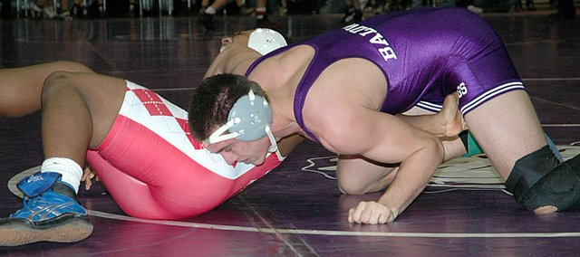 Baldwin High School junior Keenan Coffey, right, finished fourth in the 189-pound weight class at the Baldwin Invitational Tournament Saturday. BHS placed fourth at the 12-team tournament.
