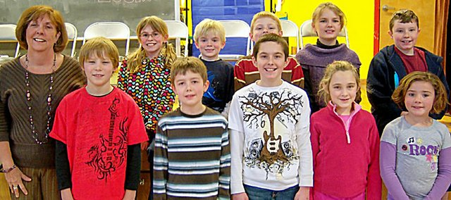 The Baldwin School District will be sending four students to the Douglas County Spelling Bee Saturday in Lawrence after they won competitions here. These are the students who competed at Marion Springs Elementary School, along with librarian Rita Tutschulte. They are front row, from left, Britten Coates, Adrian White, Elliott Stiefel, Alaina Flory and Kaylee Friend. Back row are Grace Baxter, Jonathan Brazell, Zach Montgomery, Emily Linder and Shawn Gibbs.