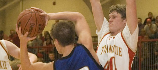Tonganoxie High senior forward Justin Jacobs forces a pass outside in the first half of the Chieftains' 53-22 defeat of Perry-Lecompton on Friday. The THS defense held the Kaws to 9-of-47 shooting.