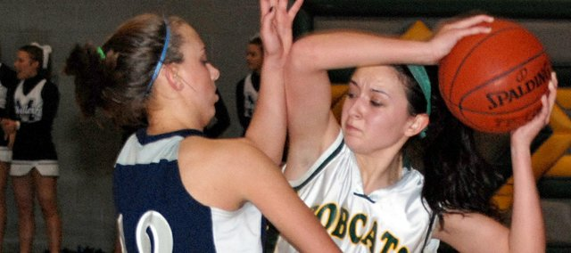 Basehor-Linwood junior point guard Courtney Poe is guarded closely by Mill Valley junior Emily Altman late in the Bobcats' 46-37 victory Friday.