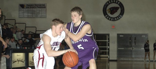 Eudora High&#39;s Evan Cleveland drives to the lane as Baldwin&#39;s Kyle Pattrick (5) defends during the third quarter Monday at Eudora. The Eudora boys beat Baldwin 43-34. 