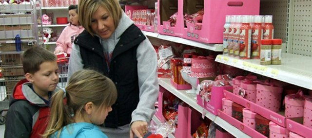 Paula Campbell, of Shawnee, shops with her son, Colin, and daughter, Abby, for Valentine's Day-related items at the Bonner Springs Wal-Mart.