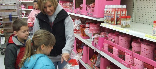 Paula Campbell, of Shawnee, shops with her son, Colin, and daughter, Abby, for Valentine's Day-related items at the Bonner Springs Walmart.
